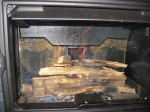"""wood fire in new soapstone stove"""
