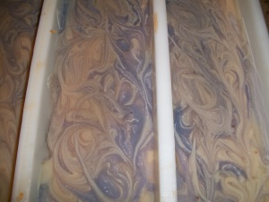 """swirled goats milk soap in the mold"""